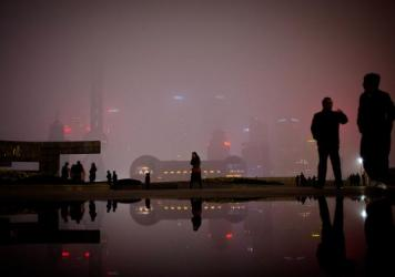 People walk on the Bund, the riverfront area next to the financial district in Shanghai. Many foreigners have descended on Shanghai to make money on China's economic expansion. NPR's Frank Langfitt met one such women as part of the free taxi rides he's b