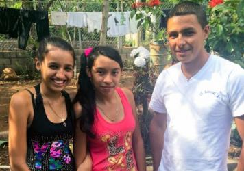 Carlos Leveron, 38, left El Salvador in 1999 and came to California to support his family. He holds pictures of his son Freddy David, 18, and his daughter Marta Elsie, 19. He has not seen either in 16 years, but a new U.S. program has raised the possibil
