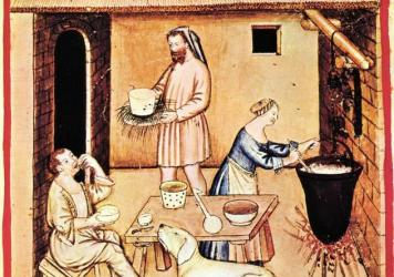A depiction of meal with cheese from <em>Tacuinum Sanitatis</em>, a medieval handbook on health and well-being based on the <em>Taqwim al‑sihha</em>, an 11th-century Arab medical treatise.