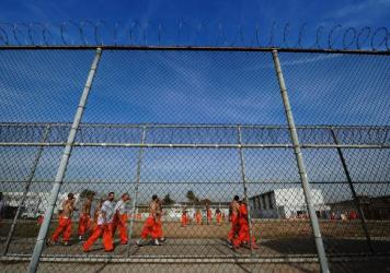 Inmates at California's Chino State Prison exercise in the prison yard in 2010. A proposition that was passed in the state last year reclassified certain crimes, releasing thousands of inmates earlier than had been anticipated.