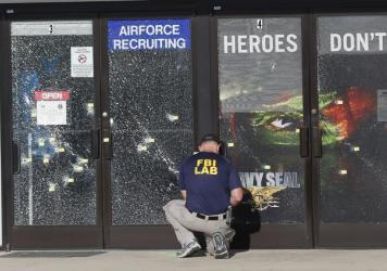 An FBI investigator at the scene of a shooting outside a military recruiting center in Chattanooga, Tenn., on Friday.
