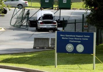 A car tangled in fencing sits inside the gate at the Naval Operational Support Center and Marine Reserve Center Friday, a day after a gunman killed four U.S. Marines in Chattanooga, Tenn.