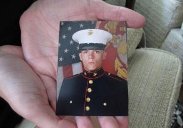 Caroline Dove holds a photo of Marine Corps Lance Cpl. Skip Wells, her boyfriend, at her home in Savannah, Ga., on Friday. Wells was among four Marines killed Thursday in Chattanooga, Tenn.