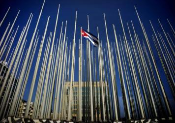 The Cuban flag is raised over their new embassy in Washington, on Monday. Cuba's blue, red and white-starred flag was hoisted Monday at the country's embassy in Washington in a symbolic move signaling the start of a new, post-Cold War era in U.S.-Cuba re