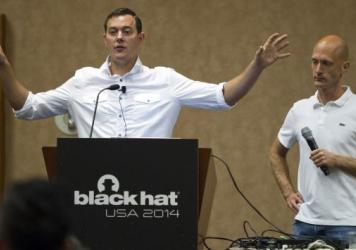 Chris Valasek (left) and Charlie Miller talk about hacking into vehicle computer systems during the Black Hat USA 2014 hacker conference in Las Vegas last August.