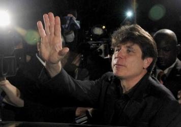 Former Illinois Gov. Rod Blagojevich waves as he departs his Chicago home for Littleton, Colo., to begin his 14-year prison sentence on March 15, 2012. The 7th U.S. Circuit Court of Appeals in Chicago on Tuesday tossed out some of Blagojevich's convictio