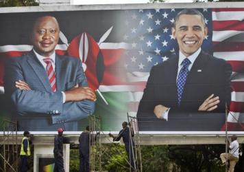 Workers finish installing a billboard showing Kenya's President Uhuru Kenyatta and President Barack Obama in downtown Nairobi a day before Obama's visit.