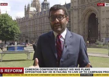 Two magicians prepare to perform a trick behind a Sky News reporter; the network says the seemingly live report was never broadcast.