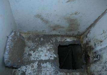 A hole in the floor of cell number 20, from which drug kingpin Joaquin Guzman escaped on July 11 from the Altiplano maximum security prison in Almoloya, Mexico.