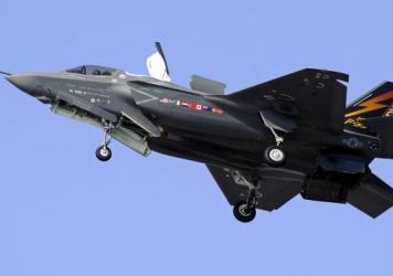 """A Marine Corps F-35B Joint Strike Fighter does a short takeoff (STOVL) from Patuxent River Naval Air Station, Md., in 2011. Eighteen years after development began, a version of the plane designed for the Marine Corps is expected to be deemed """"combat read"""