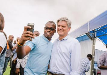 Babajide Bello of the tech company Andela takes a selfie with AOL's Steve Case after the pair played a pickup game of pingpong.