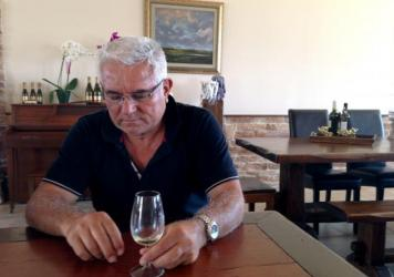 "Petros Hatzigeorgiou, whose family has been making wine for more than 150 years, at his winery outside the village of Atsiki, Lemnos. He says islanders can weather the tax by working harder. ""That's how we can fight it, no matter how much it hurts,"" he says. ""By showing them we can survive despite it."""