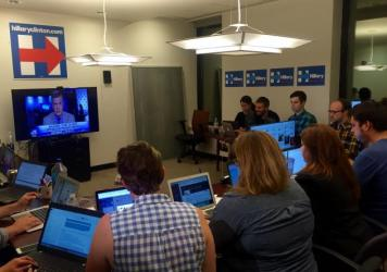The Clinton campaign's debate watch war room was actually just a conference room with a big-screen TV at the front. Fifteen or so staffers huddled over their laptops ready to pounce.