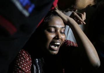 Ashamoni, wife of blogger Niloy Chakrabati, cries at her house in Dhaka, Bangladesh, on Friday after her secular activist husband was hacked to death by suspected Islamist extremists.