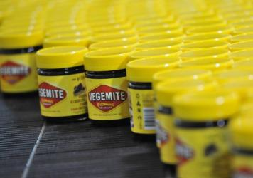 Vegemite rolls along the production line at the Vegemite factory in Melbourne, Australia, in 2013. The iconic yeast-based spread is reportedly being used to produce moonshine in officially dry communities.