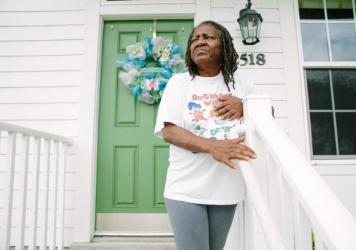 Bobbie Jennings, 69, stands outside her home in the Harmony Oaks housing development in New Orleans. Jennings says that she misses the sense of community of the Magnolia projects, the nickname of the C.J. Peete projects that Harmony Oaks replaced.