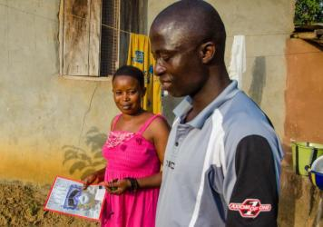 Nurse Issa French with his wife Anita, who's holding a copy of <em>Time</em> magazine's issue devoted to front-line workers. He's earned that title, treating more than 420 Ebola patients.