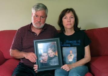 """Cris and Valerie Fiore hold one of their favorite pictures of their sons Anthony (with the dark hair) and Nick. Anthony died from a heroin overdose in May 2014 at the age of 24. Cris Fiore's <a href=""""https://www.youtube.com/watch?v=1PwFV3-0FcU"""">eulogy</a"""