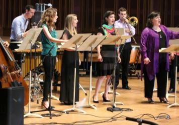 Soprano Dawn Upshaw (second from right) and fellows from Tanglewood's summer program performed the world premiere of Michael Gandolfi's <em>Carroll in Numberland </em>July 25.