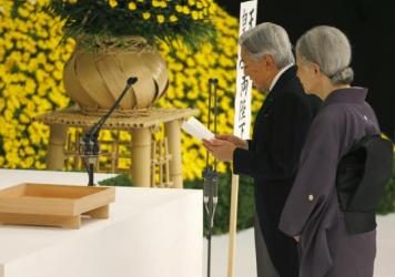 """Japan's Emperor Akihito delivers his remarks with Empress Michiko during a memorial service at Nippon Budokan martial arts hall in Tokyo, on Saturday. His expression of """"deep remorse"""" for Japan's wartime past is seen as an unprecedented apology."""