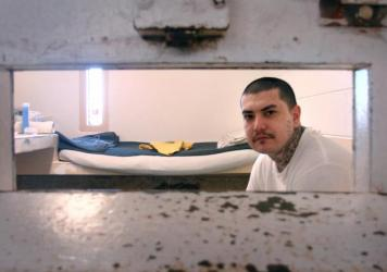 Nicklas Trujeque in his solitary confinement cell in New Mexico State Penitentiary. Inmates spend 23 hours a day in these cells, with a one-hour period in an open cell outside. According to the New Mexico ACLU, until recent state reforms, the average length of stay for an inmate here was around three years.