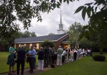 Before dawn on Sunday, the line to get into Maranatha Baptist Church was already long. The crowds were hoping to catch former President Jimmy Carter teaching his customary Sunday school class. Carter recently announced he has been diagnosed with cancer.
