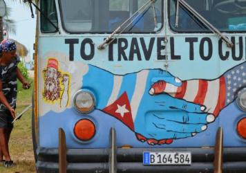 A bus with the Cuban and U.S. flags is seen on a beach in Havana, earlier this month. The White House is exploring regulatory changes to provide new opportunities for American citizens and U.S. businesses in Cuba.