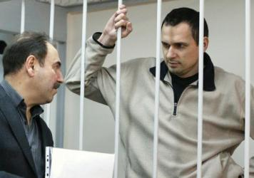 Ukrainian film director Oleg Sentsov (right), was recently convicted of terrorism charges in Crimea dating to last year, when Russia seized the territory from Ukraine. A Russian military court sentenced him to 20 years in one of several cases that have drawn criticism from human rights groups. He's shown here at a hearing at Moscow's Lefortovo District Court on Dec. 26, 2014.