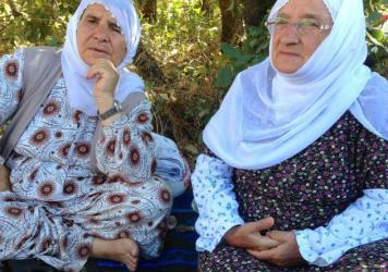 "Sakine Arat, right, and Mayrem Bulut are Kurdish mothers camping out between Turkish amry forces and the Kurdish PKK militants, in hopes of preventing clashes. ""Mothers on both sides should be doing this,"" says Arat, 80."