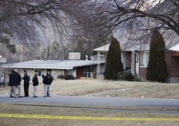 Michael Stewart stands across the street from the house where his late son Matthew David Stewart used to live in Ogden, Utah. It was raided by the local drug task force in January 2012, and an agent died in the crossfire, igniting a statewide controversy