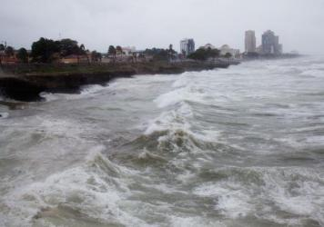 Tropical Storm Erika roils the surf off the Dominican Republic late Friday morning.