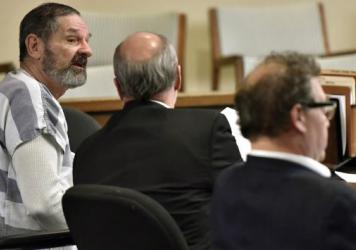 Frazier Glenn Cross Jr. (left), seen here at a hearing in Johnson County court in Olathe, Kan., last December, is a self-described white supremacist who killed three people in two attacks last spring.