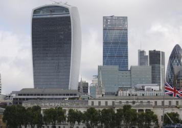 London's Walkie-Talkie building, left, took the prize this year for UK's worst building.