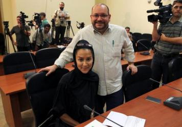 "<em>Washington Post</em> Iranian-American journalist Jason Rezaian, seen here with his wife, Yeganeh Salehi, has been held prisoner since he was arrested in Tehran last July. On Thursday, a powerful Iranian politician said of a potential prisoner swap, ""That's one way."""
