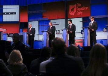 Republican presidential candidates Jim Gilmore, Lindsey Graham, Bobby Jindal and Rick Perry participate in a pre-debate forum Aug. 6 in Cleveland. The event gave airtime to seven candidates whose polling numbers were below a top-ten cutoff Fox News set t