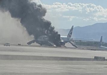 Smoke billows from a British Airways jetliner that caught fire at McCarran International Airport in Las Vegas on Tuesday. The pilot of the craft is due to retire next week.