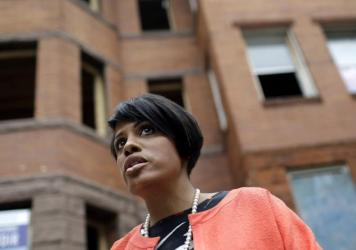 Baltimore Mayor Stephanie Rawlings-Blake stands outside vacant homes before a ceremony to kick off their restoration in Baltimore in July. In the wake of the riots triggered by the death of Freddie Gray, Rawlings-Blake announced Friday she will not seek re-election.
