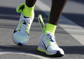 Despite the insoles sliding out of his shoes during the race, Eliud Kipchoge won the Berlin marathon in 2 hours, 4 minutes.