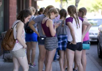 Teenage girls gather in August outside an ice cream shop in Portland, Ore. A new Pew Research Center study finds that while teens use social media and other digital tools in all aspects of their romantic relationships, most still initially meet — and break up with — their love interests face-to-face.