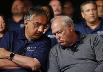 Fiat Chrysler Automobiles CEO Sergio Marchionne (left) and United Auto Workers President Dennis Williams talk back in July.