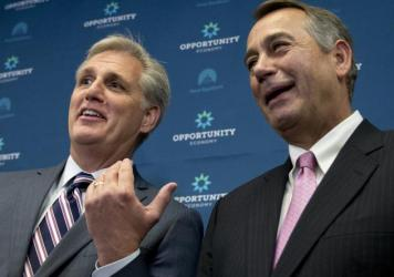 House Majority Leader Kevin McCarthy (left) of California gestures toward outgoing House Speaker John Boehner of Ohio during a news conference on Capitol Hill.