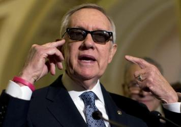Senate Minority Leader Sen. Harry Reid of Nevada says a defective exercise resistance band caused injuries to his eye, face and ribs. He and his wife are seeking more than $50,000 in damages.