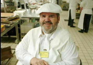 Chef Paul Prudhomme posed in the kitchen of a convention center in Jerusalem in 1996. He and 12 other chefs prepared a 12-course kosher feast as part of Jerusalem 3,000 celebrations.