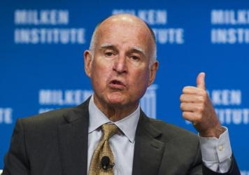 """California Gov. Jerry Brown signed into law the states so-called """"motor voter"""" law in hopes of boosting turnout in future elections. The state had 42 percent turnout in the 2014 midterms, a record low."""