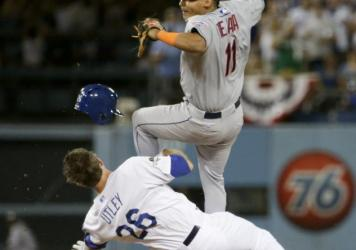 The Los Angeles Dodgers' Chase Utley slides into New York Mets shortstop Ruben Tejada during the seventh inning in Game 2 of baseball's National League Division Series on Saturday. Utley earned a two-game suspension for the play, which he has appealed.