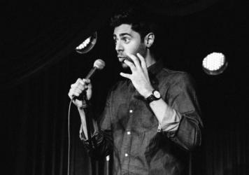 "Hasan Minhaj performs in his new one-man show ""Homecoming King""."