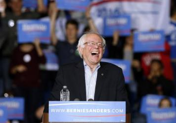 Sen. Bernie Sanders, I-Vt., laughs at a campaign event earlier this month. Sanders taped an appearance on the <em>Ellen</em> show, where he showed a lighter side.