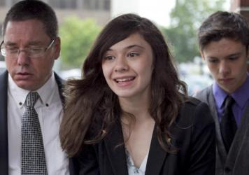 Transgender student Nicole Maines (accompanied by her father, Wayne, and her twin brother, Jonas) speaks to reporters after winning on appeal a discrimination lawsuit against her school district. In 2014, <em>Glamour Magazine</em> named Maines one of its