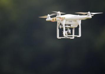 A DJI Phantom 3 drone is flown during a demonstration at an agricultual show.
