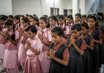 Girls start the day with a prayer at the Veerni Institute in Jodhpur, India. It's a boarding school where nearly half the students are child brides.